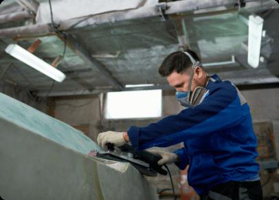 man-polishing-yacht-workshop