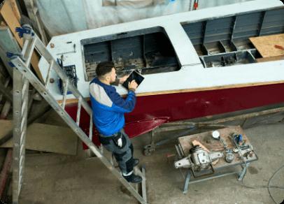 man-repairing-boats-customs-workshop